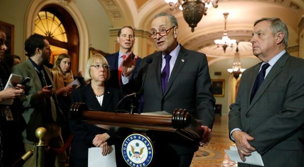 U.S. Senate Minority Leader Chuck Schumer (D-NY) (2nd L), flanked by Senator Patty Murray (D-WA) (from L), Senator Ron Wyden (D-OR) and Senator Dick Durbin (D-IL) (R).