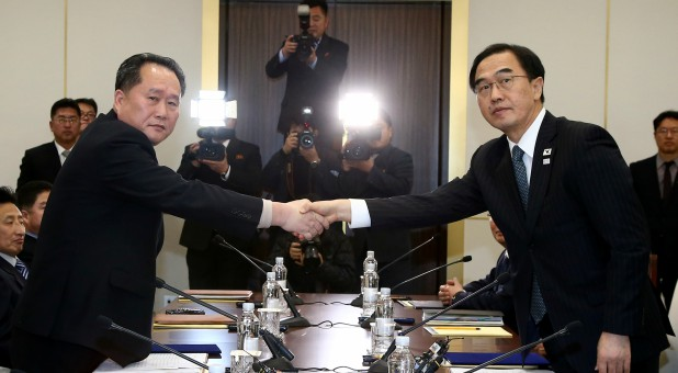 Head of the North Korean delegation, Ri Son Gwon shakes hands with South Korean counterpart Cho Myoung-gyon.