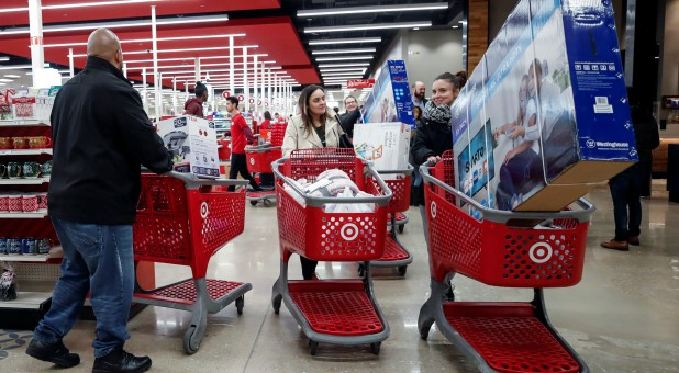 Customers push their shopping carts after making their purchases at Target in Chicago.