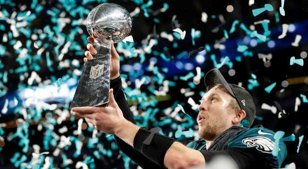 f8e03c3d6 Philadelphia Eagles  Nick Foles celebrates with the Vince Lombardi Trophy  after winning Super Bowl LII