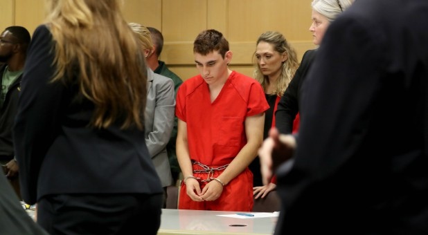 Nikolas Cruz, facing 17 charges of premeditated murder in the mass shooting at Marjory Stoneman Douglas High School in Parkland, appears in court for a status hearing in Fort Lauderdale.