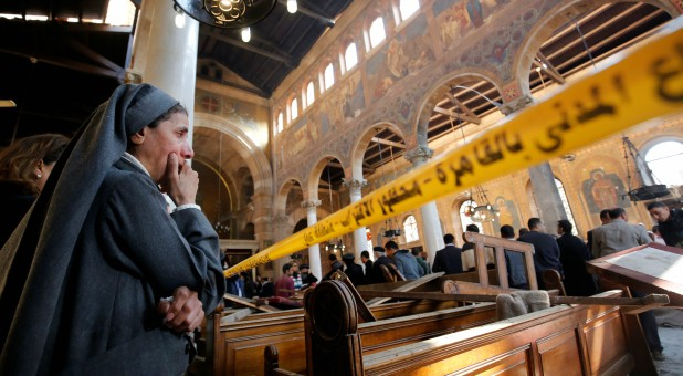 A nun cries as she stands at the scene inside Cairo's Coptic cathedral, following a bombing in Egypt, Dec. 11, 2016.