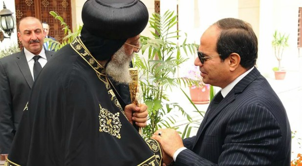 Egyptian President Abdel-Fattah el-Sissi, right, shakes hands with Pope Tawadros II, the 118th pope of the Coptic Orthodox Church of Alexandria and patriarch of the See of St. Mark Cathedral, to offer condolences for the victims of the terrorist incidents of the Palm Sunday bombings in Tanta and Alexandria, in the Abassiya Cathedral in Cairo, on April 13, 2017.