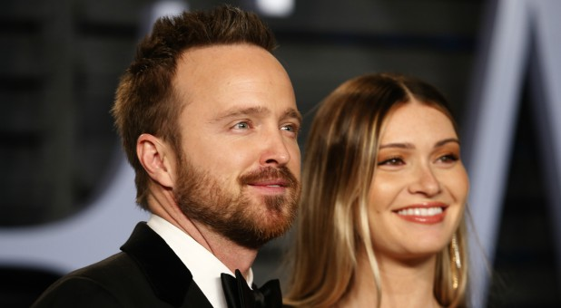 "Aaron Paul, left, stars in ""The Path."""