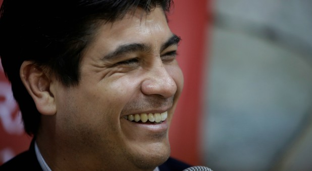 Carlos Alvarado, presidential candidate of the ruling Citizens' Action Party (PAC), smiles as he addresses the media in San Jose, Costa Rica.