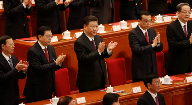 Chinese President Xi Jinping, Chinese Premier Li Keqiang and other top officials clap their hands during the closing session of the National People's Congress.