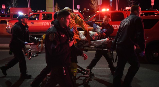Paramedics and members of the NYFD perform CPR on a victim of a helicopter that crashed into the East River in New York.