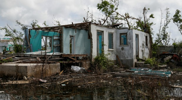 Homes sit in ruins at Codrington on the island of Barbuda just after a month after Hurricane Irma struck the Caribbean.