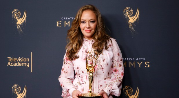 "Leah Remini holds her Emmy Award for Outstanding Informational Series or Special for ""Leah Remini: Scientology and the Aftermath."""