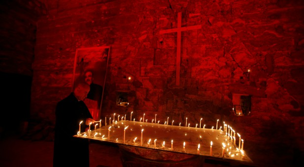 Chaldean Church of St. Paul is illuminated with red light in protest against the persecution of Christians around the world, particularly in Syria and Iraq, in Mosul, Iraq.