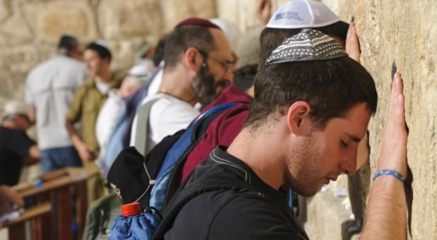 Men pray at the Western Wall.