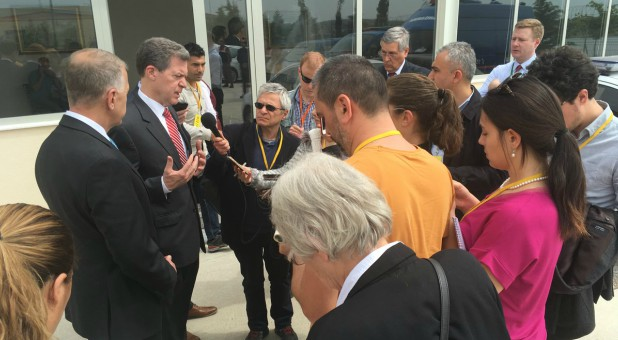 Ambassador Brownback talks to the press after Pastor Andrew Brunson's hearing in Izmir, Turkey.