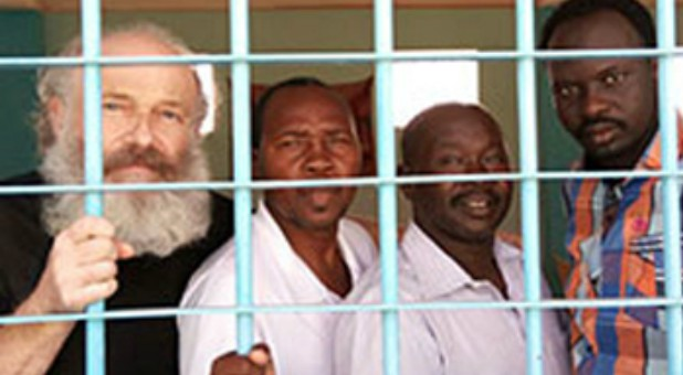 Petr behind bars with other Christian prisoners.