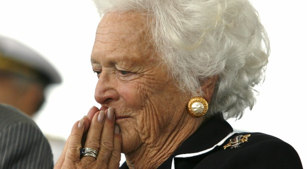 ormer first lady Barbara Bush listens to remarks during the christening ceremony of the USS George H.W. Bush at Northrop-Grumman's shipyard in Newport News, Virginia, U.S., October 7, 2006.