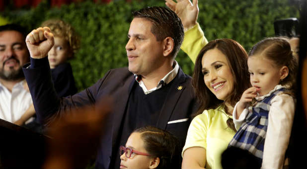 Fabricio Alvarado, presidential candidate of the National Restoration party (PRN), greets supporters next to his wife and daughter before delivering a speech during a rally after Costa Rica's presidential election in San Jose, Costa Rica, Feb. 4, 2018.
