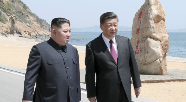 The leaders of the two Koreas.