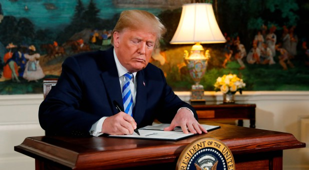 U.S. President Donald Trump signs a proclamation declaring his intention to withdraw from the JCPOA Iran nuclear agreement.