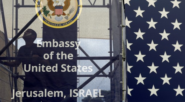 A worker is seen inside the new U.S. embassy compound during preparations for its opening ceremony, in Jerusalem.
