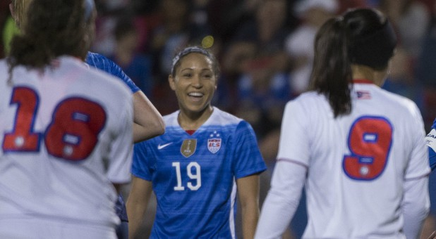 United States defender Jaelene Hinkle (19) and midfielder Carli Lloyd (10) and defender Kelley O'Hara (5) celebrate.