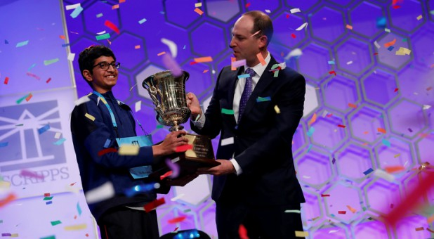 Karthik Nemmani celebrates with E.W. Scripps Company CEO Adam Symson after winning the Scripps National Spelling Bee.