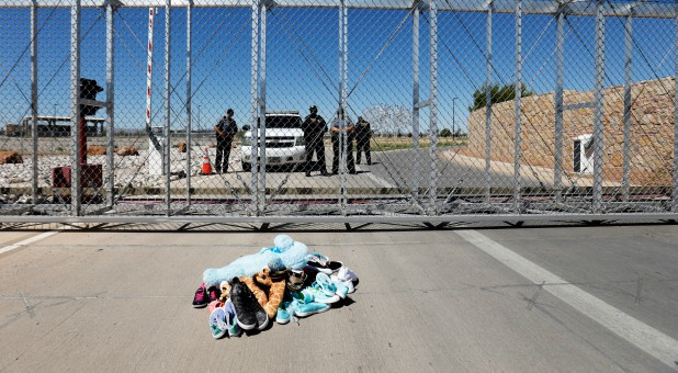 Shoes and toys are left at the gate in protest by a bipartisan delegation of mayors from across the country at a detention facility where children of migrants are being held, at the port of entry in Tornillo, Texas.