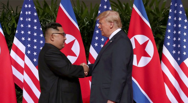 President Donald Trump shakes hands with North Korean leader Kim Jong Un at the Capella Hotel on Sentosa island in Singapore.