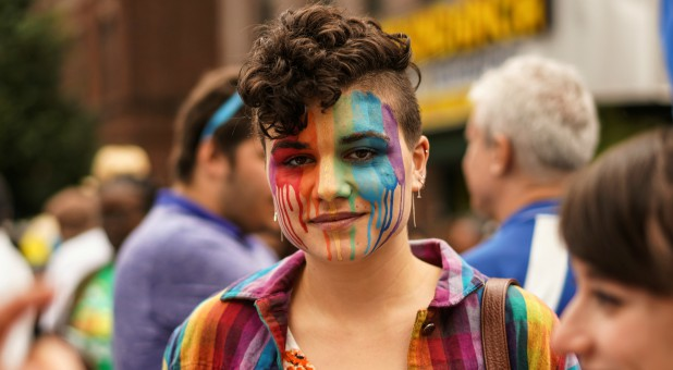 A person poses for photo at the Pride day parade in the Queens borough of New York City.
