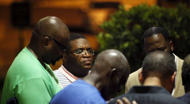 Members of Emanuel AME Church pray for one another.