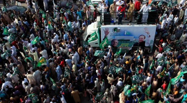 Supporters of the Pakistan Muslim League - Nawaz (PML-N) chant and march towards the airport to welcome ousted Prime Minister Nawaz Sharif and his daughter Maryam, in Lahore, Pakistan.