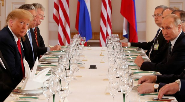 U.S. President Donald Trump participates in an expanded bilateral meeting with Russia's President Vladimir Putin.