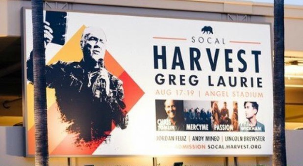 A billboard for the upcoming Harvest Crusade.