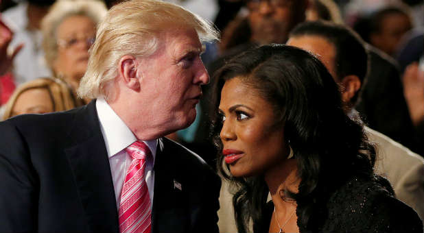 Republican presidential nominee Donald Trump and Omarosa Manigault attend a church service, in Detroit, Michigan, U.S., Sept. 3, 2016.