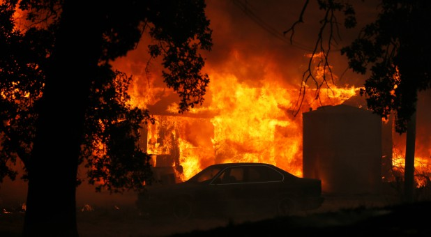 A structure burns out of control in the River Fire (Mendocino Complex) in Lakeport, California.