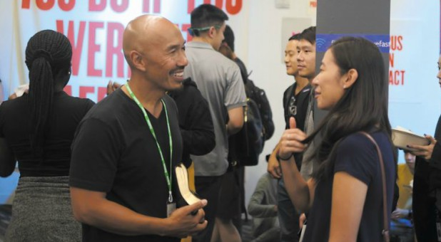 Francis Chan speaks with a woman.