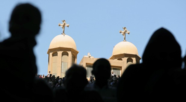 Coptic Orthodox Christians attend a Palm Sunday mass at the Samaan el-Kharaz Monastery in the Mokattam Mountain area of Cairo.
