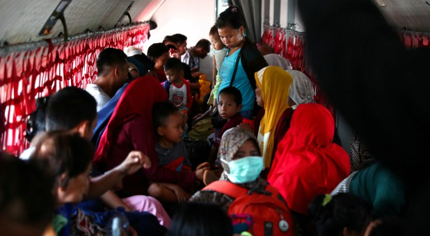 Local residents affected by the earthquake and tsunami are seen on a military aircraft at Mutiara Sis Al Jufri Airport in Palu, Central Sulawesi, Indonesia.