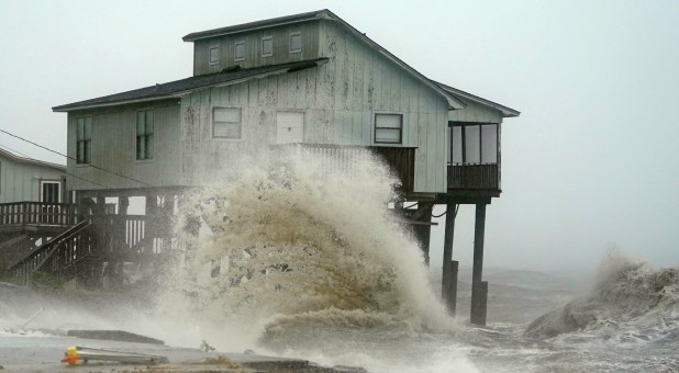 Waves take over a house as Hurricane Michael comes ashore in Alligator Point, Florida.