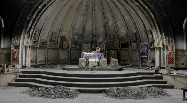 An altar of a damaged church is seen in the town of Qaraqosh, south of Mosul, Iraq.