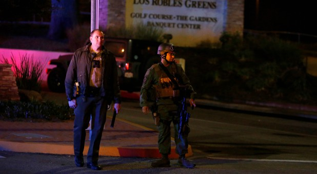 Police guard the site of a mass shooting at a bar in Thousand Oaks, California.