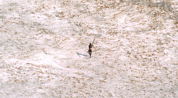 A Sentinel tribal man aims with his bow and arrow at an Indian Coast Guard helicopter as it flies over the island for a survey of the damage caused by the tsunami in India's Andaman and Nicobar archipelago.