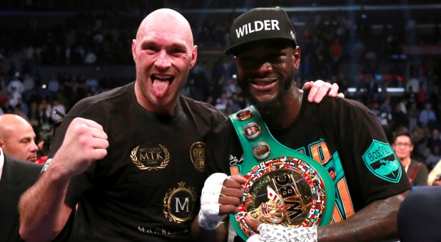 Tyson Fury, left, with Deontay Wilder