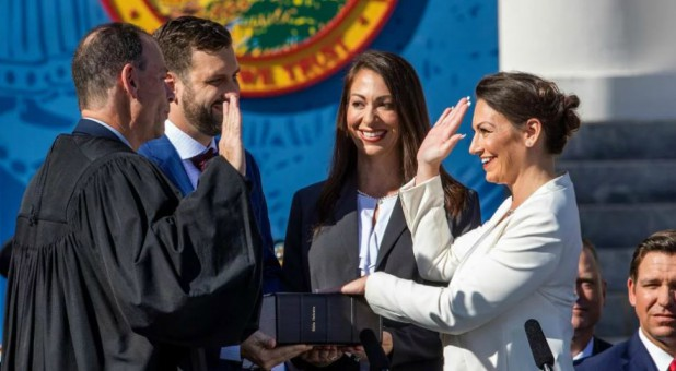 Nikki Fried, right, is sworn in as Florida's commissioner of agriculture on Jan. 8, 2019. Fried's left hand is placed on the first Hebrew Bible published in America.