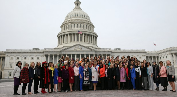 U.S. House Speaker Nancy Pelosi, D-Calif., poses with most of the House Democratic women.