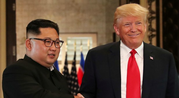 U.S. President Donald Trump and North Korea's leader Kim Jong Un shake hands after signing documents during a summit at the Capella Hotel on the resort island of Sentosa, Singapore.