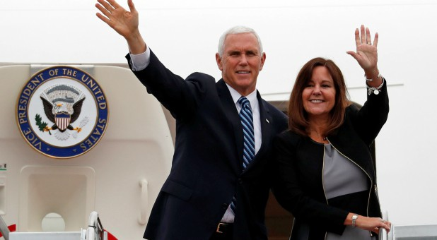 U.S. Vice President Mike Pence and his wife, Karen, wave as they board the Air Force Two at Yokota U.S. Air Force Base in Fussa, on the outskirts of Tokyo, Japan.