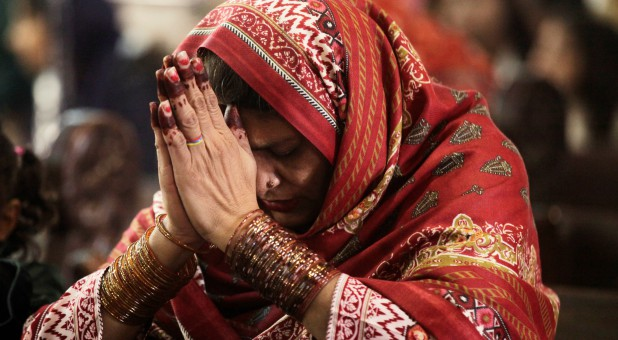 A Pakistani Christian woman prays during Mass.