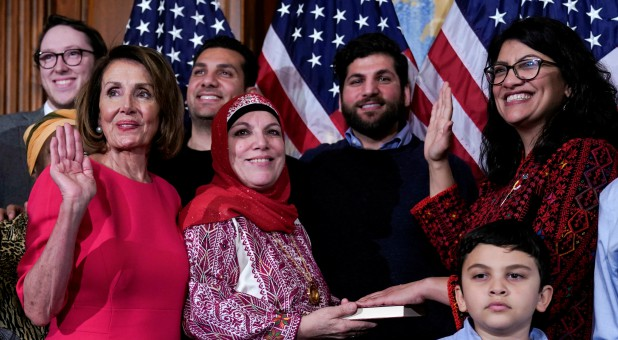 Rep. Rashida Tlaib, D-Mich., poses with Speaker of the House Nancy Pelosi, D-Calif., for a ceremonial swearing-in picture on Capitol Hill.