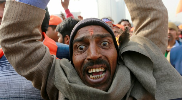 "A supporter of the Vishva Hindu Parishad (VHP), a Hindu nationalist organization, shouts religious slogans during ""Dharma Sabha,"" or a religious congregation."