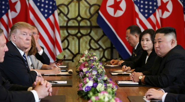 North Korea's leader Kim Jong Un and U.S. President Donald Trump look on during the extended bilateral meeting in the Metropole hotel during the second North Korea-U.S. summit in Hanoi, Vietnam.