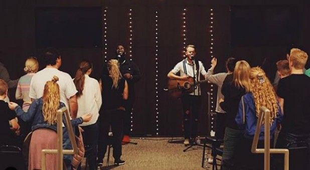 Edward Byrd, front left, and Joshua Buchanan, front right, lead worship.